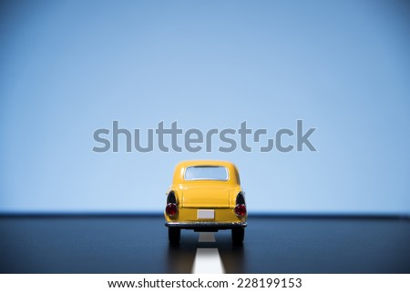 Classic fifties scale model toy car from back view. - stock photo