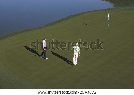 Classic golf course in Palm Springs, CA, hole 18 - stock photo