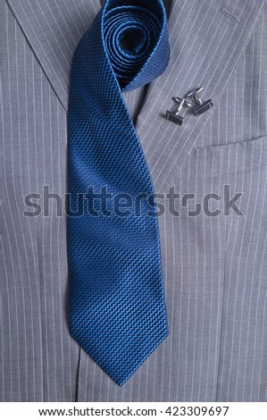 Classic gray striped business suit with blue tie and cuff-links. Fashion and classic trends - stock photo