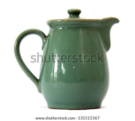 Classic Green ceramic Earthenware jug for milk or gravy - stock photo