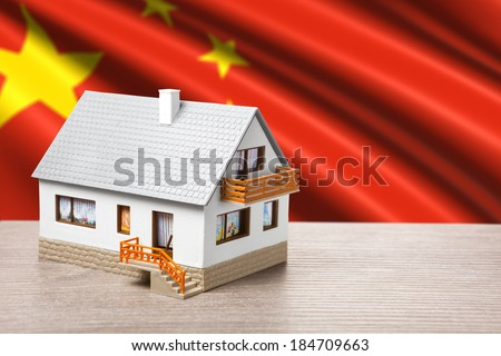 classic house against Chinese flag background - stock photo