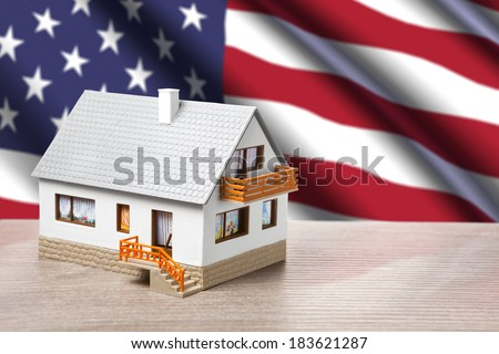 classic house against USA flag background - stock photo