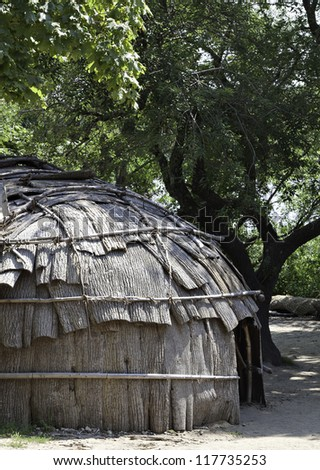 Classic hut used by the native American Wampanoag tribe at Plimoth plantation - stock photo