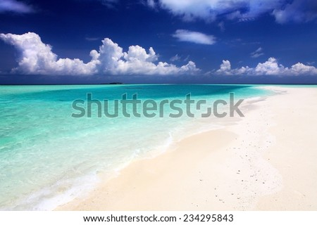 classic idyllic beach scene with sea and sand - stock photo