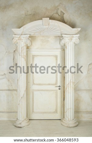 Classic interior with columns and closed door  - stock photo
