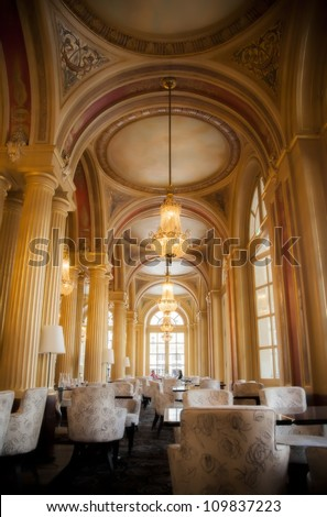classic interior with golden columns - stock photo