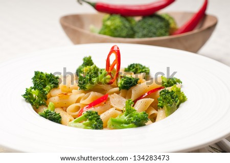 classic Italian penne pasta with broccoli and red chili pepper - stock photo