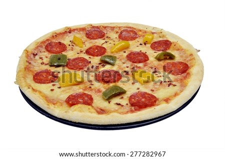 Classic italian pizza margherita with salami, pepperoni, oregano and peppers isolated in black plate on white background. Point of view - stock photo