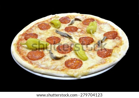 Classic italian pizza with mozzarella chees, pepperoni, anchovies and green peppers whole isolated in white plate on white background. Point of view - stock photo