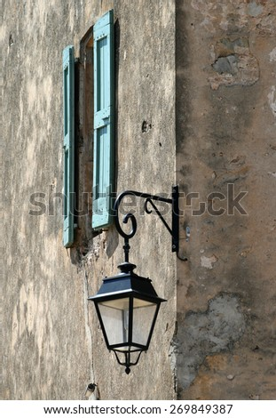 Classic lantern on wall - stock photo