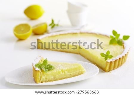 Classic Lemon Custard Tarte on white background - stock photo