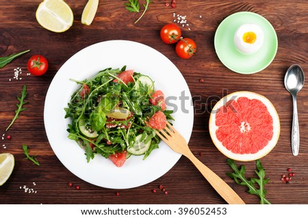 Classic low-calorie diet with salad, boiled eggs and grapefruit. Useful vegetarian food. - stock photo
