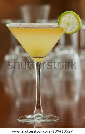 classic margarita served chilled in a martini glass with a float of orange liqueur - stock photo