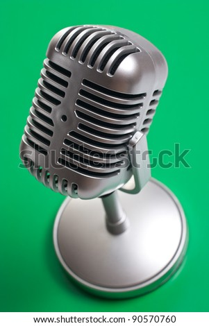 Classic microphone isolated over white - stock photo