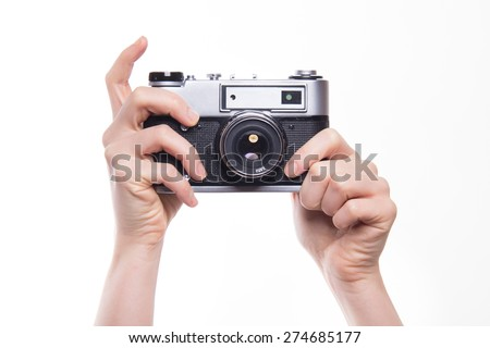 Classic 35mm old analog camera on white - studio shoot  - stock photo