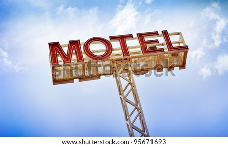Classic motel sign against blue sky - stock photo