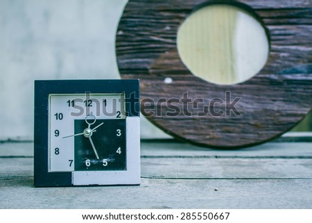 Classic old clock on a wooden - stock photo