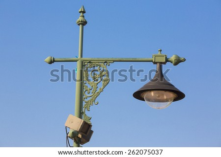 Classic Old Street Lamp On Blue Sky - stock photo