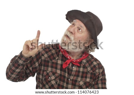Classic Old West style cowboy with battered felt hat and whiskers looks up and points. Isolated on white, horizontal, copy space. - stock photo
