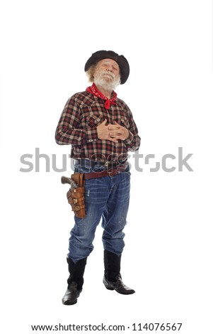 Classic Old West style cowboy with felt hat, grey whiskers, revolver, stands clasping hands against chest. Isolated on white background, copy space, vertical. - stock photo