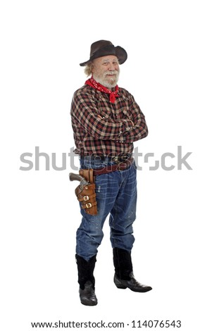 Classic Old West style smiling cowboy with felt hat, grey whiskers, revolver, stands with arms crossed. Isolated on white background, copy space, vertical. - stock photo