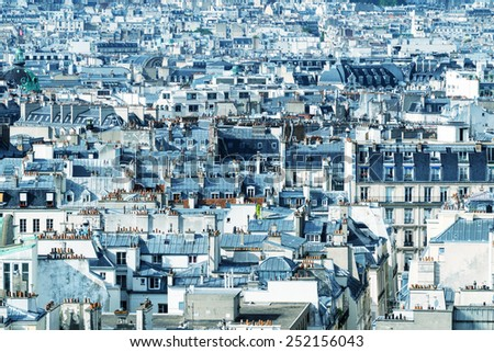 Classic Parisian buildings. Aerial view of roofs. - stock photo