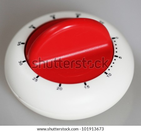Classic plastic kitchen timer  on gray background - stock photo