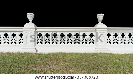 Classic railing with grass isolated on black background - stock photo