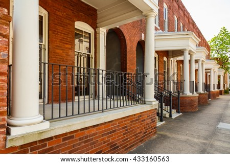 Classic red brick architecture in the historic downtown district of Savannah, Georgia. - stock photo