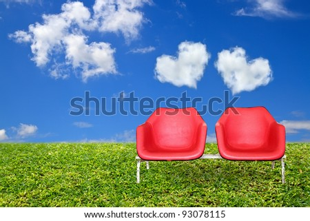 Classic red chair. Cloudy skies and a beautiful heart. - stock photo