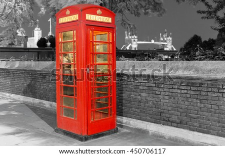 Classic, red telephone booth in front of the Tower of London - stock photo