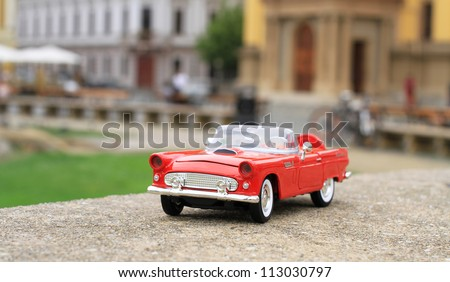 Classic red toy car - stock photo