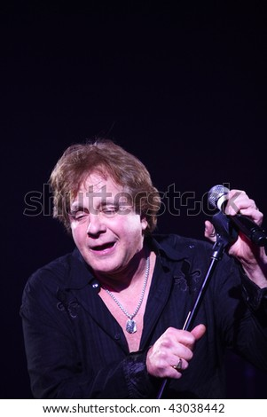classic rocker Eddie Money performs an acoustic set of his chart-topping hits for fans at the Celebrity Theatre on December 17, 2009 in Phoenix AZ. - stock photo