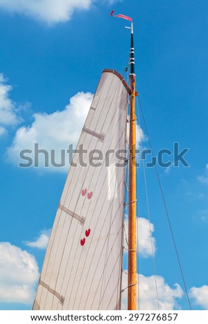 Classic sail with the two hearted Dutch provincial symbol of Frisia - stock photo