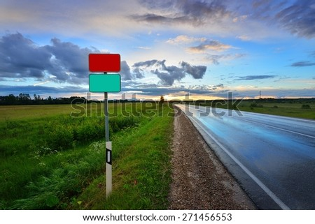 classic scene of a highway in rural area with blank road signs - stock photo