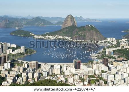 Classic scenic skyline overlook view of Rio de Janeiro city with Sugarloaf Mountain, Botafogo, and Guanabara Bay - stock photo