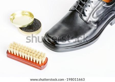 Classic shiny black men's shoe, boot polish and brush - stock photo