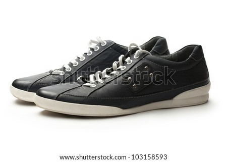 Classic sneakers with white lace - stock photo