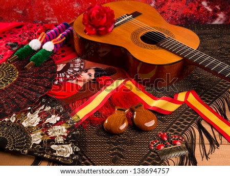 Classic spanish guitar with flamenco elements as comb fan and castanets - stock photo