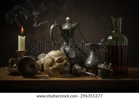 Classic still life with old objects and burning candle. - stock photo