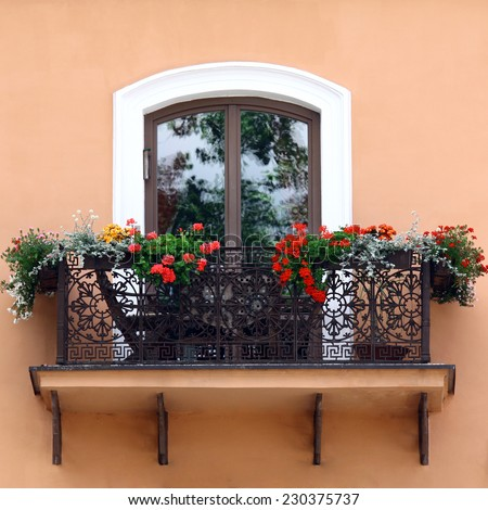 Classic style balcony with flowers at summer time - stock photo