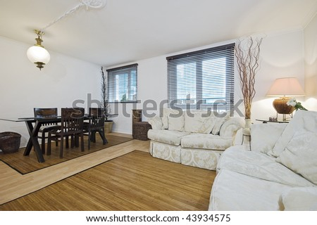 classic style living room with dining area - stock photo