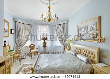 Classic style luxury bedroom interior in blue colors with boudoir and window - stock photo
