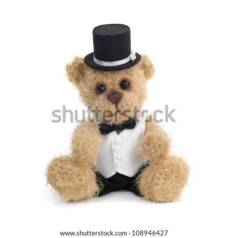 Classic teddy bear gentleman sitting on white - stock photo