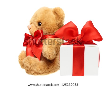 Classic teddy bear with red bow and present box isolated on white background - stock photo
