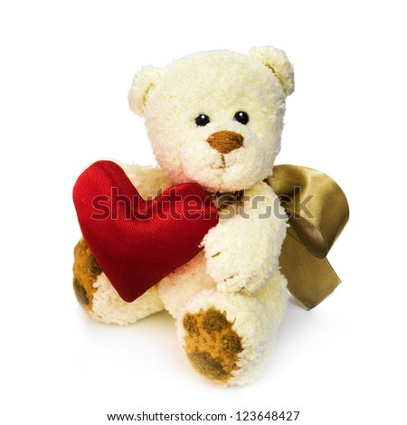 Classic teddy bear with Valentine day heart - stock photo