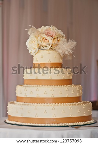 Classic tiered wedding cake at luxury reception - stock photo