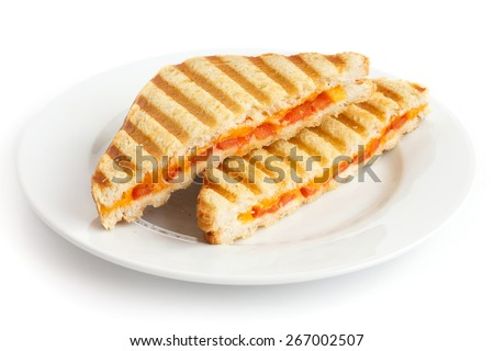 Classic tomato and cheese toasted sandwich on white plate. - stock photo