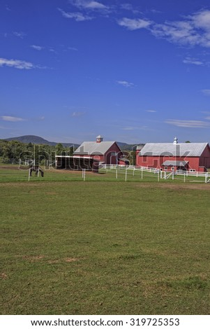Classic Vermont horse farm with copy space above and below. - stock photo
