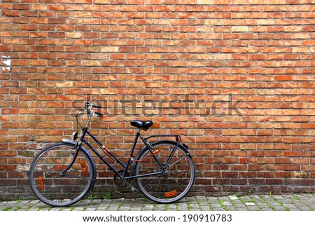 Classic view of Bike and wall # 1 - stock photo